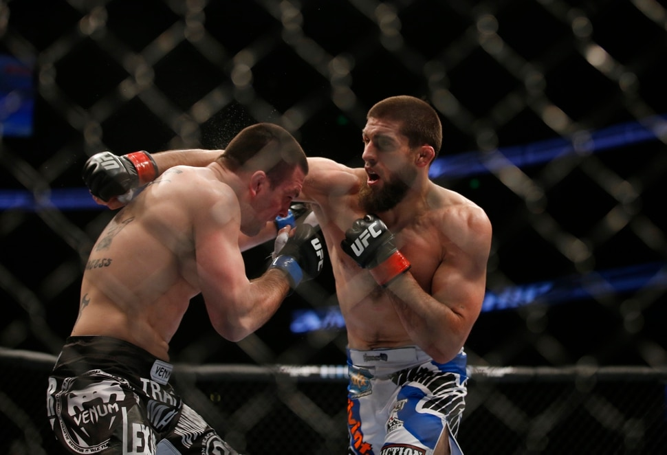 Court McGee, right, and Josh Neer trade punched during their UFC welterweight mixed martial arts match in Anaheim, Calif., Saturday, Feb. 23, 2013. (AP Photo/Jae C. Hong)