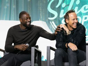 (Francisco Kjolseth   The Salt Lake Tribune) Dwyane Wade,  three-time NBA champion and part owner of the Utah Jazz   joins Ryan Smith, Founder and Executive Chairman of Qualtrics and owner of the Utah Jazz as they joke around on stage during the Silicon Slopes Tech Summit in Salt Lake City on Wednesday, Oct. 13, 2021.