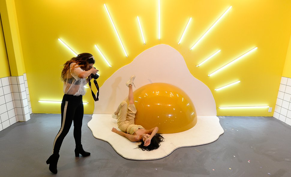 (Francisco Kjolseth | The Salt Lake Tribune) Jiajing Yi poses for Maiya Buck in the egg room at Hall of Breakfast, a quirky new art exhibit that celebrates the first meal of the day. Each room celebrates a favorite breakfast food from bacon to cereal to coffee. The exhibit runs through July 9.