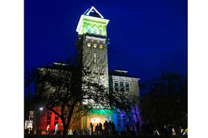 (Eli Lucero |Herald Journal) Old Main on the campus of Utah State University is lit up in rainbow colors on Tuesday, April 13, 2021, in Logan.