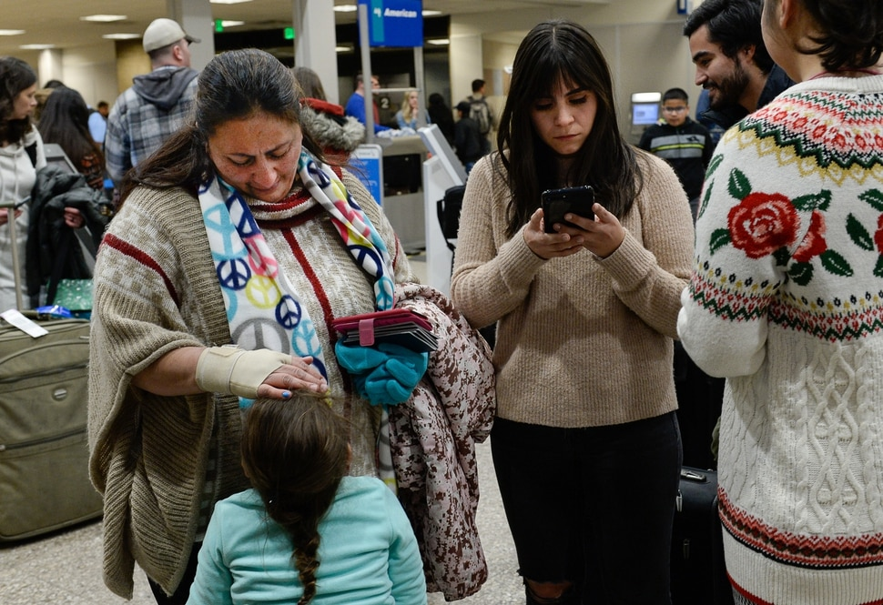 (Francisco Kjolseth | The Salt Lake Tribune) Maria Santiago Garcia, left, faced with a deportation order to return to her home country of Guatemala, embraces her daughter Natalie Fajardo, 3, during the last hour of Christmas night before catching the red-eye flight with her four children, who are all U.S. citizens.