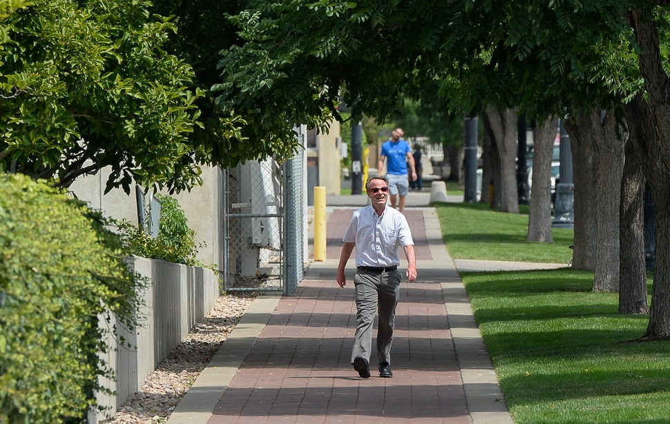 (Francisco Kjolseth | The Salt Lake Tribune) Salt Lake Tribune editor Dave Noyce finishes his race against colleagues after using his own two feet in a transportation race from Library Square to the Tribune building at the Gateway on Thursday, Aug. 2, 2018. Modes of transportation included, rentable electric scooters, Green Bike, TRAX, Lyft, and walking.
