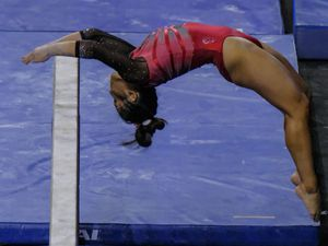 (Leah Hogsten | The Salt Lake Tribune)  Cristal Isa on the beam as the University of Utah competes at the NCAA regional championships Saturday, April 3, 2021 at the Maverik Center.