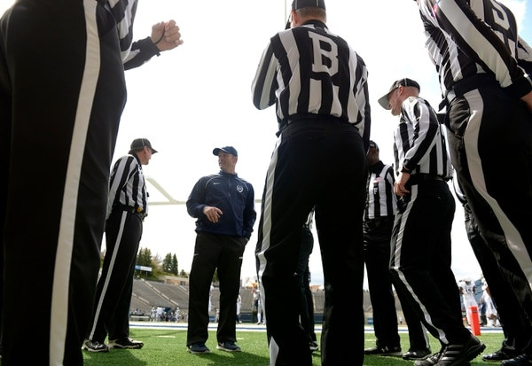 Leah Hogsten | The Salt Lake Tribune Utah State University football team head coach Matt Wells talks with referees prior to the team's annual Blue vs. White Spring Game, Saturday, April 8, on Merlin Olsen Field at Maverik Stadium.