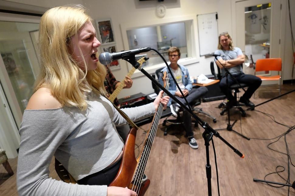 (Francisco Kjolseth | The Salt Lake Tribune) Tallulah Schweitz, 16, belts out the lyrics for Smells Like Teen Sprit while playing the base with other students at MusicGarage.org, in Sugarhouse on Monday, May 20, 2019. Kids learn to rock and roll in hopes of joining a kids band to perform at festivals this Summer.