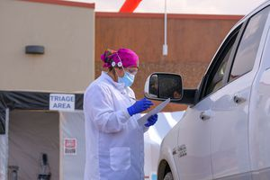 (Leah Hogsten | Tribune file photo) Brenda Vijil, a Diné medical assistant at Utah Navajo Health System's Monument Valley Clinic, records an incoming patient's personal information before admittance into the triage unit to take vitals and administer a coronavirus test. Aug. 24, 2020.