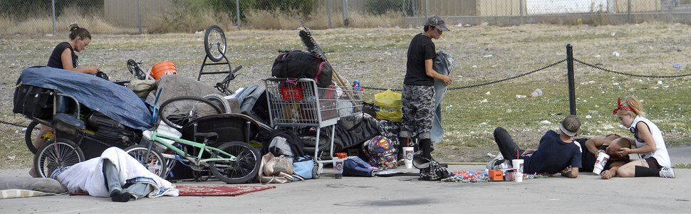 Al Hartmann | The Salt Lake Tribune People sleep on sidewalk with their belongings and makeshift shelters near 300 S. and 500 W. Wednesday morning July 19. Camping on the street is a class B misdemeanor and can now be enforced.
