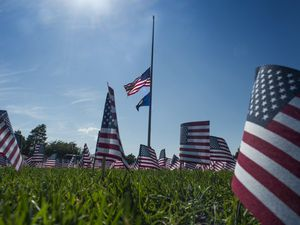 (Rick Egan  |  Tribune file photo) A display of 3,000 flags wave in the grass in front of Skyline High School in 2018, in memory of those who lost their lives on Sept. 11, 2001.