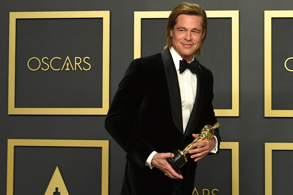 (Jordan Strauss | Invision/AP) Brad Pitt, winner of the award for best performance by an actor in a supporting role for Once Upon a Time in Hollywood, poses in the press room at the Oscars on Sunday, Feb. 9, 2020, at the Dolby Theatre in Los Angeles.