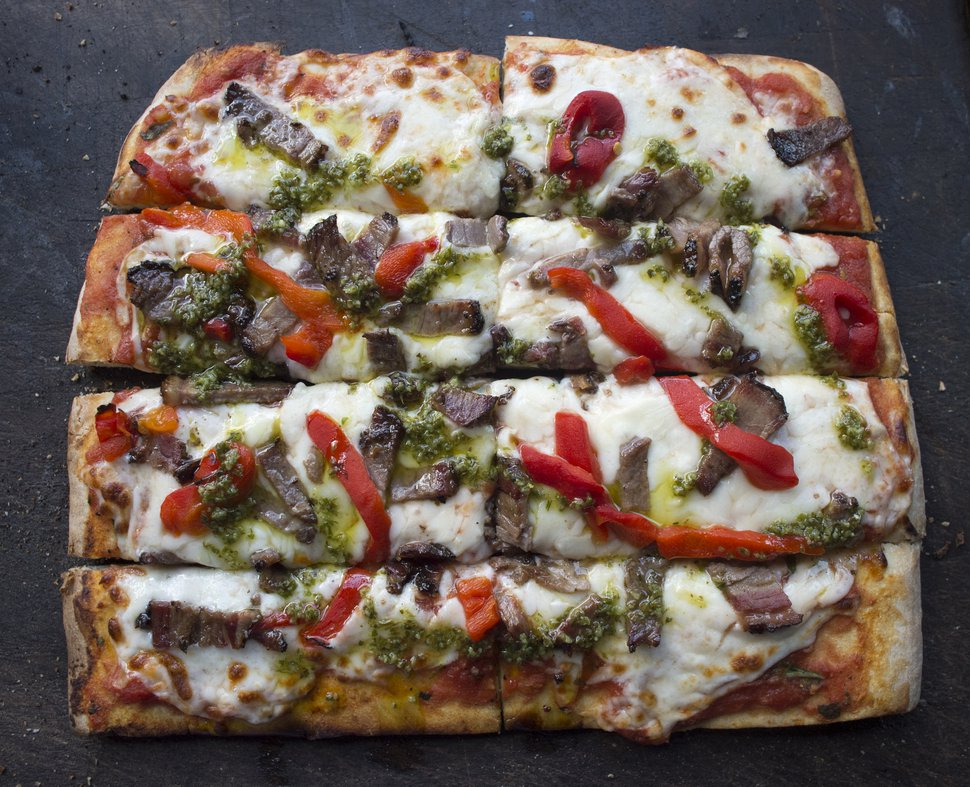 (Rick Egan | The Salt Lake Tribune) The Criolla pizza with smoked beef brisket, red peppers with homemade chimichurri from the Umani food truck.