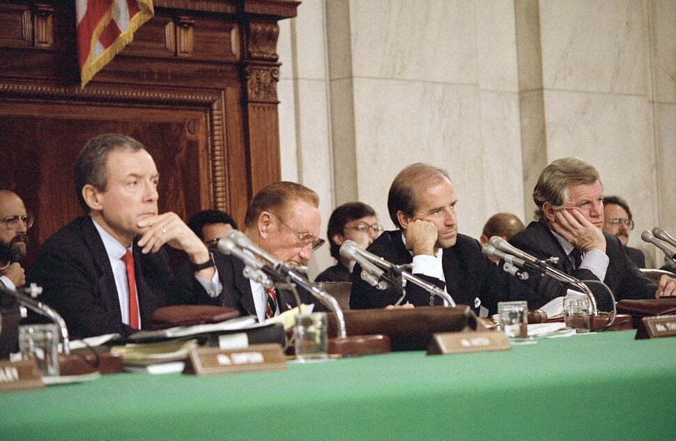 (John Duricka | AP Photo) Senate Judiciary Committee Chairman Joseph Biden, D-Del., left, and Sen. Edward Kennedy, D-Mass., right, listen during witness confirmation hearings for Supreme Court nominee Robert H. Bork, Sept. 21, 1987 in Washington. Far left is Orrin Hatch, R-Utah, and Strom Thurmond, R-S.C.