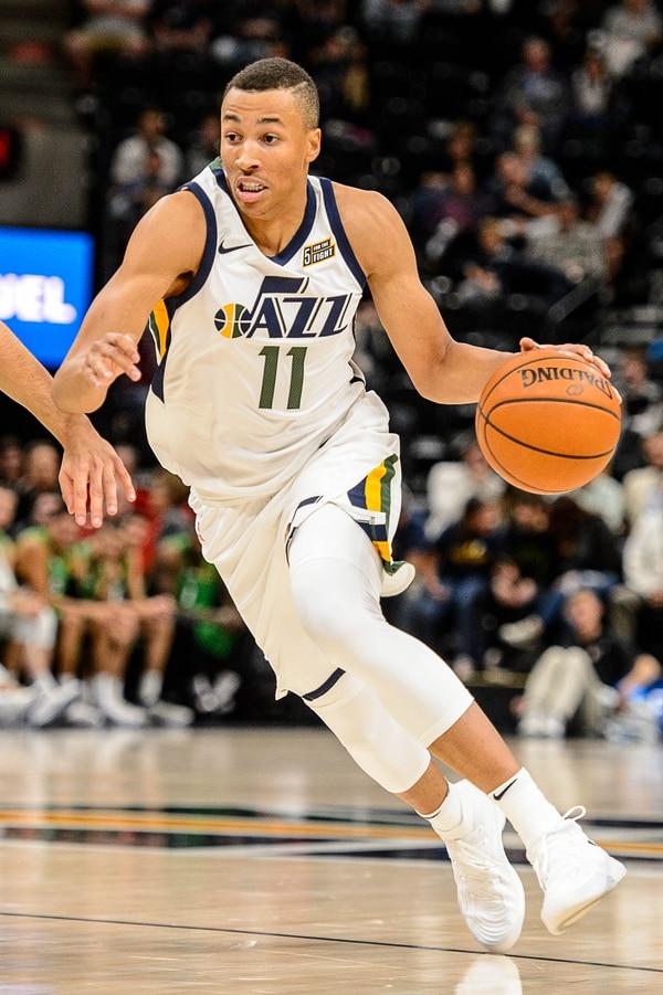 (Trent Nelson   The Salt Lake Tribune) Utah Jazz guard Dante Exum (11) drives on Maccabi Haifa's Roi Huber as the Utah Jazz host Maccabi Haifa, preseason NBA basketball at Vivint Smart Home Arena in Salt Lake City Wednesday October 4, 2017.