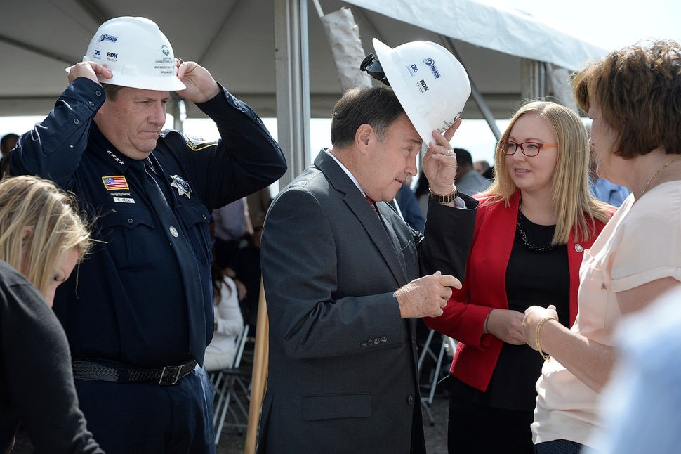 (Scott Sommerdorf | The Salt Lake Tribune) Rollin Cook, left, Exec. Director of Utah Dept. of Corrections, and Utah Governor Gary Herbert, try on their hard hats prior to using their shovels to turn some dirt a the site of the new prison, Wednesday, August 16, 2017.