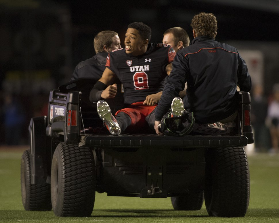 Rick Egan | The Salt Lake Tribune Utah Utes wide receiver Tim Patrick (9) tries to rally his team as he is taken off the field, after being injured in the 3rd quarter, in PAC-12 action, Utah vs. Oregon game, at Rice-Eccles Stadium, Saturday, November 8, 2014