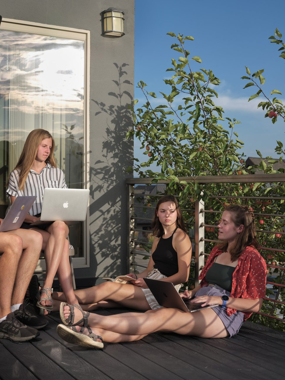 (Lindsay D'addato | The New York Times) A group of Grinnell College students studies on the deck of their own off-campus housing group in Salt Lake City, Aug. 25, 2020.