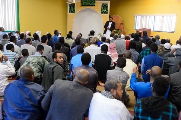 Trent Nelson | The Salt Lake Tribune Imam Yussef Abdi speaks to men gathered for Friday prayers at Madina Masjid Islamic Center in Salt Lake City, Friday March 10, 2017. Religious and community leaders gathered at the center in support of their Muslim Brothers and Sisters, regarding ICE activities and the detention of a Kenyan couple.