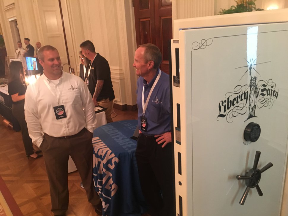 (Thomas Burr | The Salt Lake Tribune) Justin Buck, left, the vice president of sales and marketing of Utah-based Liberty Safe, and the company's president and CEO, Steve Allred, show off their Presidential 50 safe during an event at the White House on Monday as part of the Trump administration's push for American-made products.