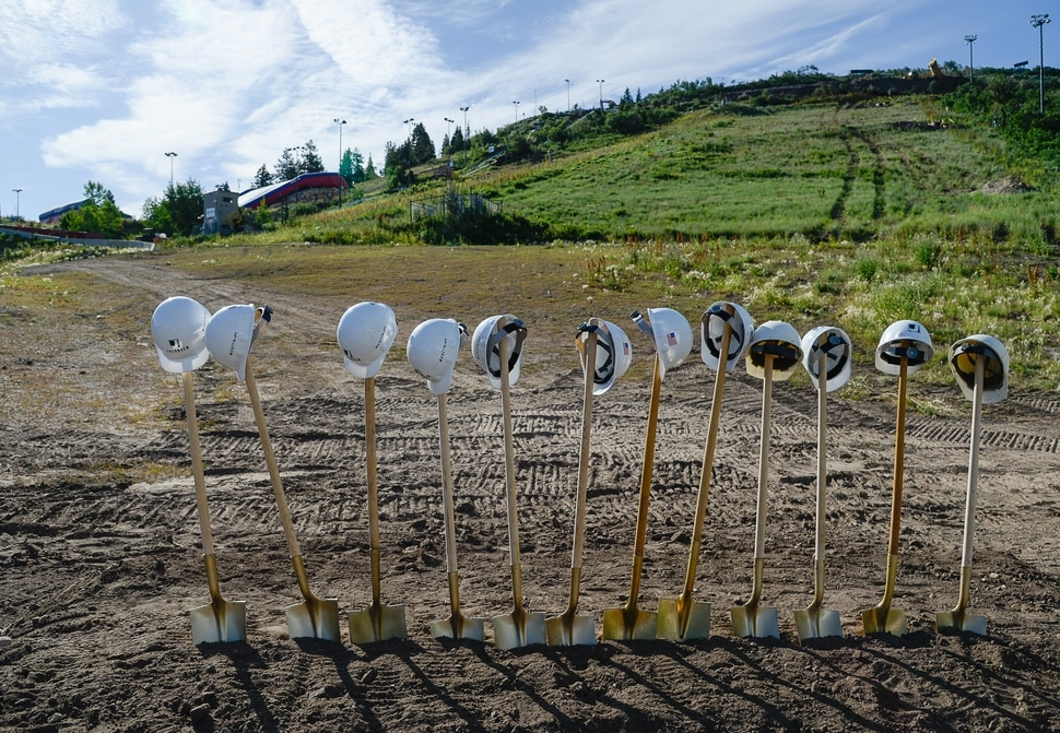 (Francisco Kjolseth | The Salt Lake Tribune) Utah Olympic Park holds a ground breaking ceremony for the new Mountain Expansion project in background on Tuesday, July 23, 2019. The Mountain Expansion is an athlete-focused project that will provide enhanced opportunities for Utah's ski and snowboarding athletes, expanding their season locally and increasing the quantity and quality of training options.