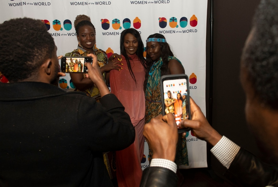 (Rick Egan | The Salt Lake Tribune) Guests snap photos of some of models, Sandrine Ingabire, Burundi, Noon Taha , Sudan, and Margaret Mathew, South Sudan, after they walked the runway, at the 9th annual Women of the World Fashion Show Gala, Wednesday, March 6, 2019.