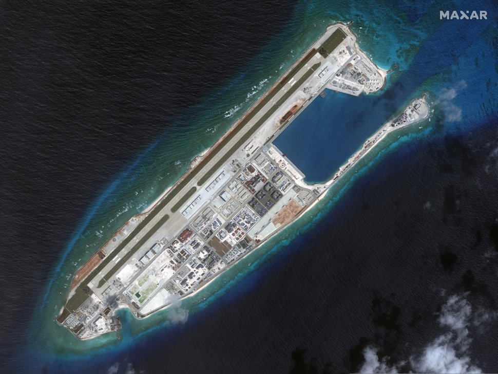 (Satellite image ©2019 Maxar Technologies via AP) This March 2017 image provided by Maxar Technologies shows a satellite image of Fiery Cross Reef in Spratly island chain in the South China Sea.
