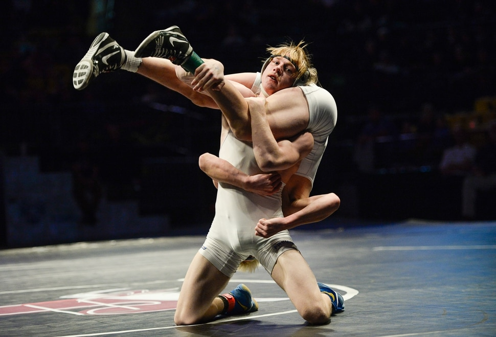 (Francisco Kjolseth | The Salt Lake Tribune) Oakley Ridge of Pleasant Grove is lifted by Kegan Leatherow of Fremont in the Class 6A 120 state wrestling championship match at the Utah Valley University UCCU Center on Thursday, Feb. 8, 2018.