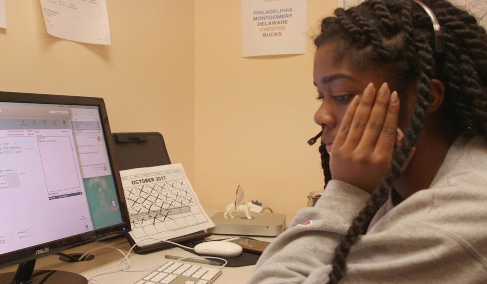 (Image courtesy of Janet Goldwater | Sundance Institute) An operator staffs a phone line in a scene from Abortion Helpline, This is Lisa, directed by Barbara Attie, Janet Goldwater and Mike Attie, an official selection of the Shorts Programs at the 2020 Sundance Film Festival.