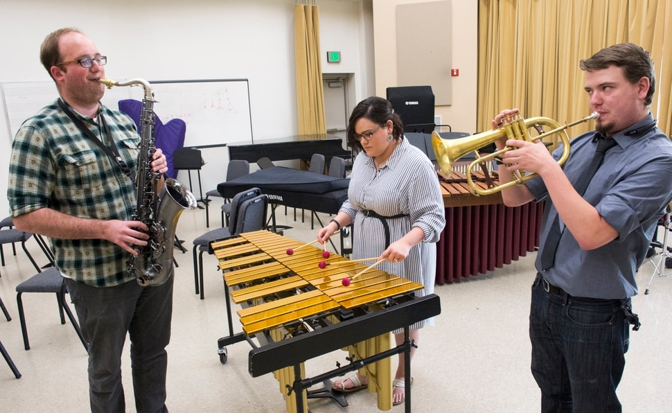 (Rick Egan | The Salt Lake Tribune) Dixie State University students Chris Flinders, Courtney Gordon and James Hetrick practice in the music room on campus. Each of them has spoken out against the way the university handled the terminations of music professor Ken Peterson and Glenn Webb, the recently terminated music department chair. Friday, April 6, 2018.