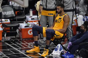 Utah Jazz center Rudy Gobert sits on the bench during the first half in Game 4 of a second-round NBA basketball playoff series against the Los Angeles Clippers Monday, June 14, 2021, in Los Angeles. (AP Photo/Mark J. Terrill)