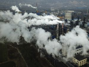 (Sam McNeil | AP file photo)  In this Nov. 28, 2019, photo, smoke and steam rise from a coal processing plant in Hejin in central China's Shanxi Province. Chinese President Xi Jinping says his country will aim to stop pumping additional carbon dioxide, the main global warming gas, into the atmosphere by 2060. Xi's announcement during a speech Tuesday, Sept. 22, 2020, to the U.N. General Assembly is a significant step for the world's biggest emitter of greenhouse gases and was immediately cheered by climate campaigners.