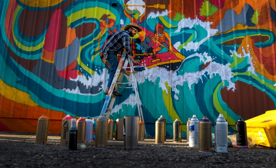(Leah Hogsten | The Salt Lake Tribune) Muralist Matt Monsoon paints on the wall of the Commonwealth Room during the 2nd annual Mural Fest sponsored by South Salt Lake Arts Council and Utah Arts Alliance. Ten murals were created in South Salt Lake's community between 2100 and 2400 South off of West Temple, May 11, 2019.