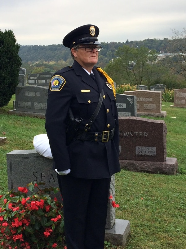 (Courtesy of Utah Department of Corrections) Utah Corrections Honor Guard Commander Sue Partridge stands at attention during a ceremony held for Officer Edwin J. Fisher. Fisher was killed June 1, 1955, by an inmate at the Utah State Prison and was laid to rest in an unmarked grave until Wednesday, Oct. 11, 2017, when the Utah Department of Corrections and Utah Law Enforcement Memorial board dedicated a headstone at his Frankfort, Ky., burial site.