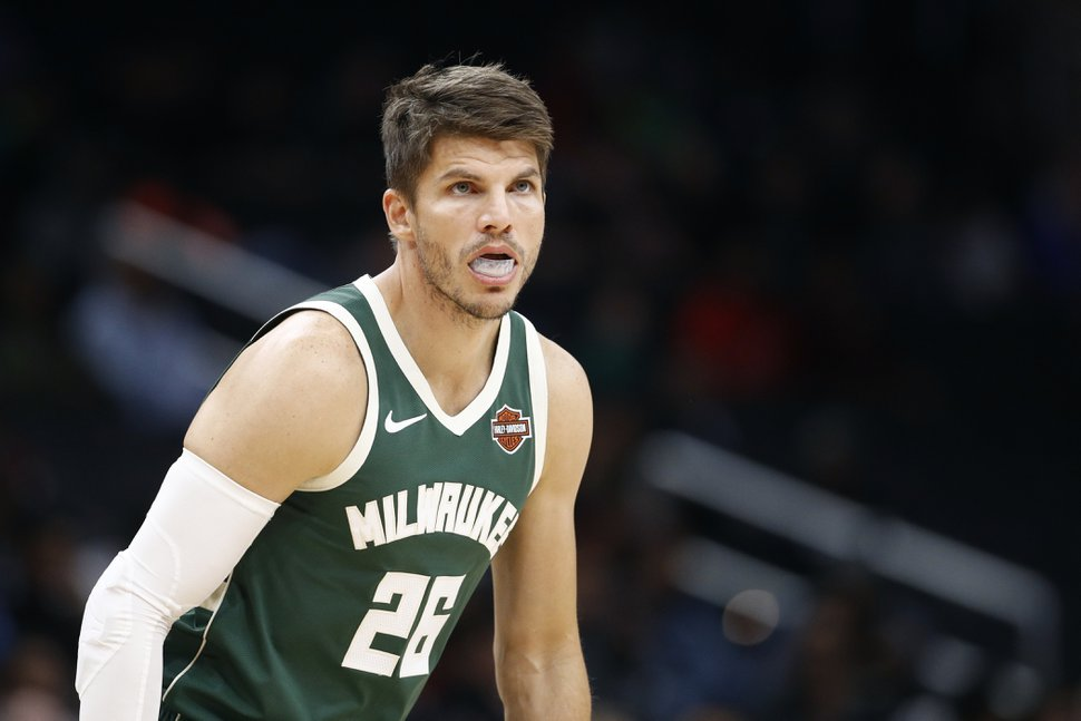 Milwaukee Bucks guard Kyle Korver stands on the court in the first half of an NBA preseason basketball game against the Washington Wizards, Sunday, Oct. 13, 2019, in Washington. (AP Photo/Patrick Semansky)