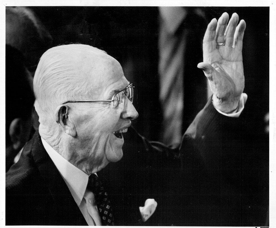 (Tribune file photo) Latter-day Saint leader Ezra Taft Benson waves to a youth choir.