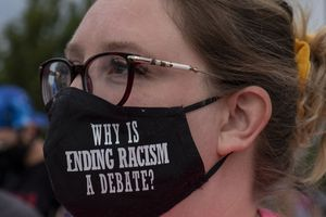 (Leah Hogsten  |  The Salt Lake Tribune) Jessy Salas with Black Lives for Humanity sports a handmade mask from the Mayes family. Black Lives Matter supporters and Salt Lake Equal Rights Movement members march from the Capitol to Washington Square on Monday, August 31, 2020 calling for justice for Jacob Blake who was shot in the back by police in Kenosha, Wisconsin on August 23rd.