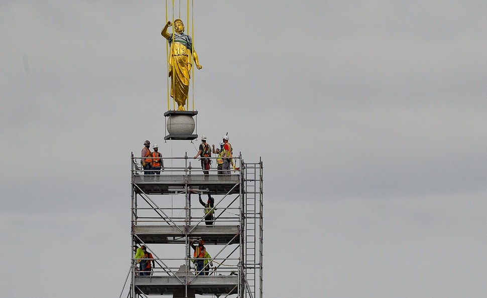 (Francisco Kjolseth | The Salt Lake Tribune) Crews work to remove the Angel Moroni statue atop the Salt Lake Temple of The Church of Jesus Christ of Latter-day Saints on Monday, May 18, 2020. The temple closed in December for seismic upgrades and sustained minor damager during the March 18, 2020, magnitude 5.7 earthquake when the trumpet held by the angel fell off and several smaller spire stones were displaced.