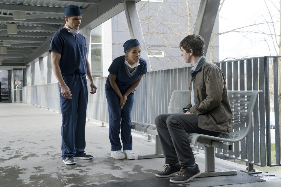 "(Photo: Liane Hentscher/ABC) Dr. Neil Melendez (Nicholas Gonzalez) and Dr. Claire Brown (Antonio Thomas) talk to Dr. Shaun Murphy (Freddie Highmore) like he is a simpleton in ""The Good Doctor."""