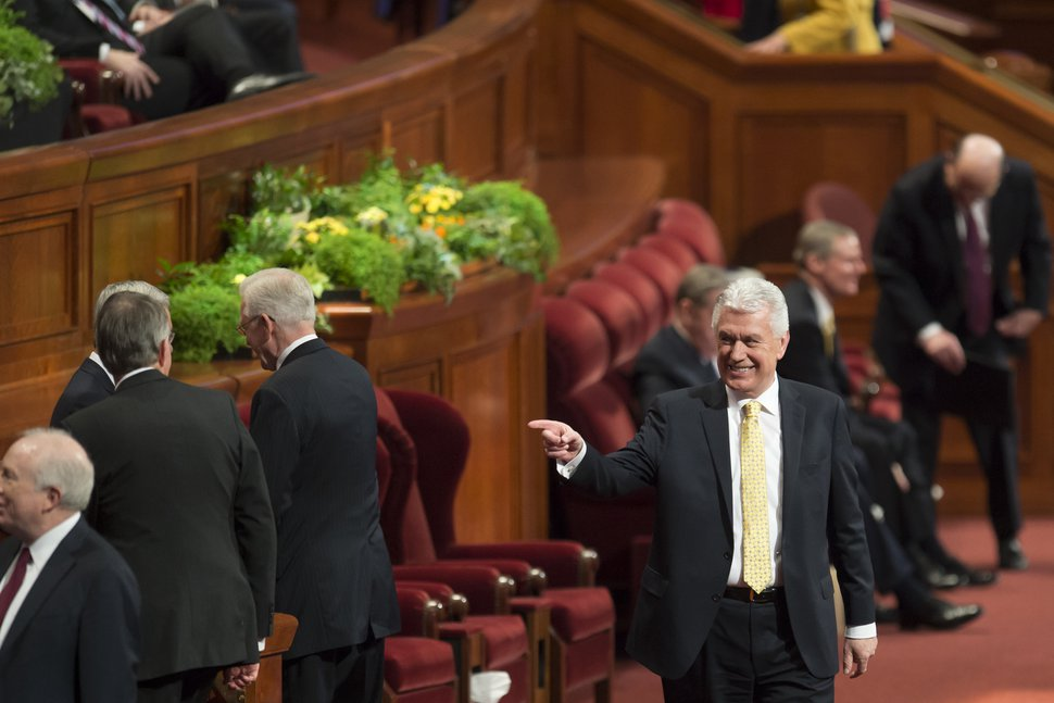 (Jeremy Harmon | The Salt Lake Tribune) Elder Dieter F. Uchtdorf greets other General Authorities at the start of the Sunday afternoon session of General Conference on April 1, 2018.