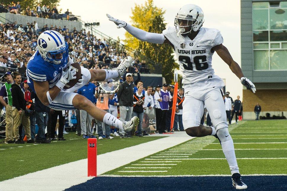 (Chris Detrick   The Salt Lake Tribune) Brigham Young Cougars wide receiver Beau Tanner (33) makes a touchdown catch past Utah State Aggies cornerback Ja'Marcus Ingram (36) during the game at Merlin Olsen Field at Maverik Stadium Friday, September 29, 2017.