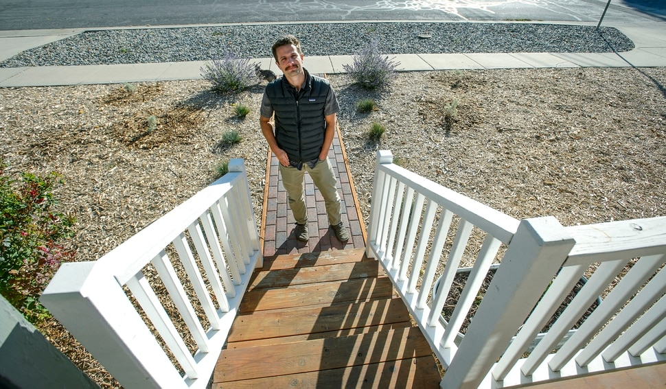 (Steve Griffin | The Salt Lake Tribune) Mickey Campbell stands outside his Salt Lake City home, Thursday October 5, 2017, where he was told by the city his yard violated a law requiring at least 33% of front yard and park strip to be covered in vegetation.