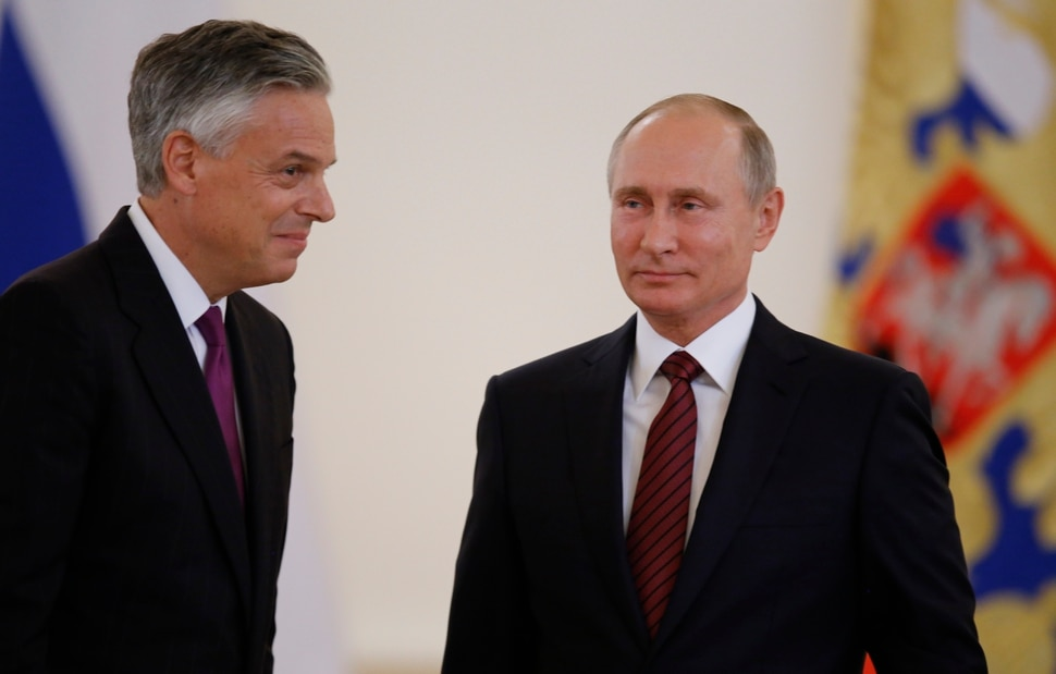U.S. Ambassador Jon Huntsman, left, walks after presenting credentials to Russian President Vladimir Putin, right, during a ceremony in the Kremlin in Moscow, Russia, on Tuesday, Oct. 3, 2017. The new U.S. Ambassador to Russia presented his credentials to President Vladimir Putin in the Kremlin on Monday amid investigations into Moscow's meddling in the 2016 U.S. elections. (AP Photo/Pavel Golovkin, Pool)