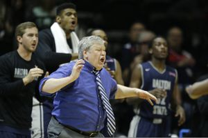 FILE - Dalton State coach Tony Ingle directs his team during the second half of the NAIA championship basketball game against Westmont in Kansas City, Mo., in this Tuesday, March 24, 2015, file photo. Dalton State defeated Westmont 71-53. Tony Ingle, who failed to win a game in his tenure as BYU's interim basketball coach but went on to capture lower-division national championships at two Georgia colleges, has died at the age of 68. His son, Izzy, announced on Twitter that Ingle died Monday night, Jan. 18, 2021, of complications from COVID-19.(AP Photo/Orlin Wagner, File)