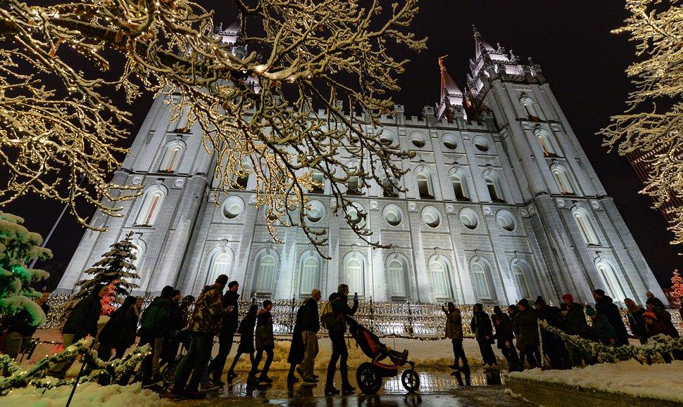 (Francisco Kjolseth | The Salt Lake Tribune) Visitors take in the sights as Temple Square in Salt Lake City comes to life Friday, Nov. 29, 2019.
