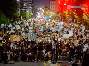 (Trent Nelson  |   Tribune file photo) Protesters march against police brutality in Salt Lake City on Thursday, June 4, 2020. A Utah state lawmaker may be backing off -- or at least revising -- his proposed bill to create a criminal defense for accidentally running over a protester.
