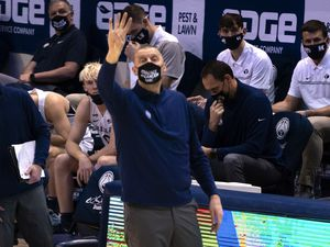 (Rick Egan | The Salt Lake Tribune)  Brigham Young Cougars head coach Mark Pope signals to his team, in basketball action at the Marriott Center in Provo, on Saturday, Jan. 30, 2021.