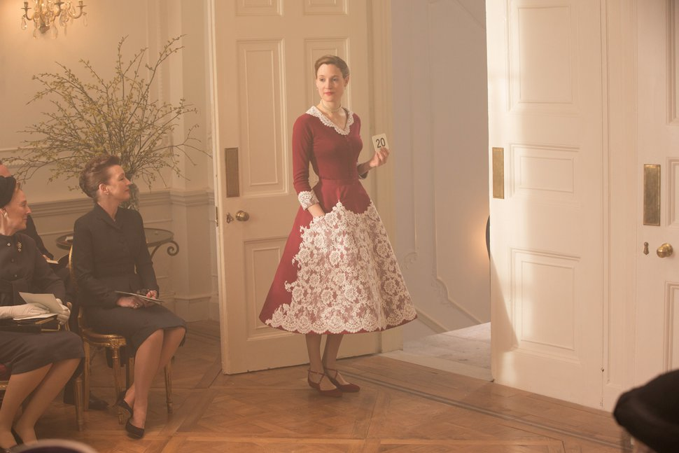 This image released by Focus Features shows Lesley Manville, seated left, and Vicky Krieps in a scene from