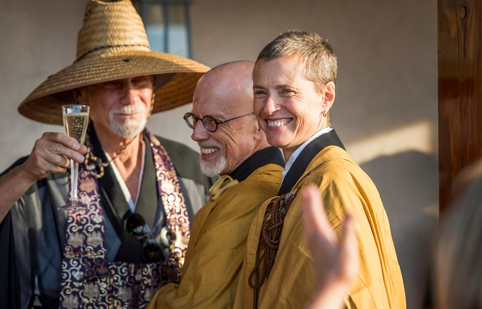 (Leah Hogsten | The Salt Lake Tribune) Genpo Merzel Roshi, from left, celebrates with Michael Mugaku Zimmerman Sensei and Diane Musho Hamilton Sensei after the dedication and eye opening ceremony at Torrey Zendo Meditation Center, Sept. 13, 2017, in Torrey. The Torrey Zendo, founded by Zimmerman and Hamilton, is now a year-round facility for Zen study, practice and retreats.