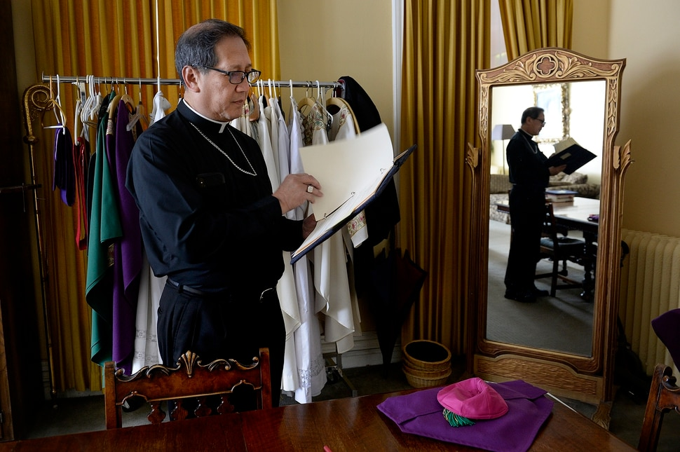 Scott Sommerdorf | The Salt Lake Tribune Catholic Bishop Oscar A. Solis looks through the order for the Mass on the third Sunday of Lent, Sunday, March 4, 2018. March 7th will mark his first anniversary of his installation as the tenth Bishop of Salt Lake City.