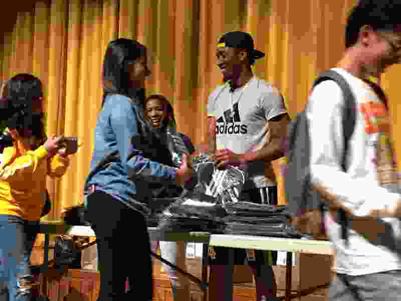 Donovan Mitchell visits Kearns High on Tuesday to hand out backpacks and T-shirts