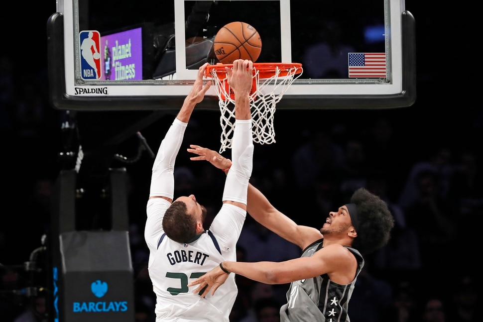 Brooklyn Nets center Jarrett Allen (31) defends against Utah Jazz center Rudy Gobert (27), who dunks the ball during the first quarter of an NBA basketball game Tuesday, Jan. 14, 2020, in New York. (AP Photo/Kathy Willens)