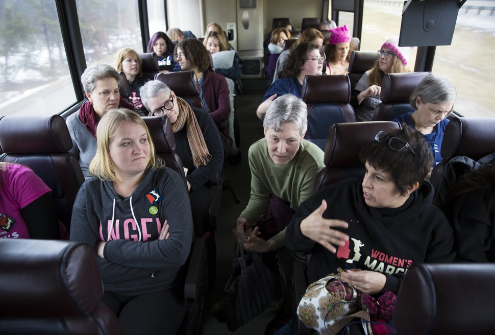 Women ride a bus to Washington for the Women's March, Friday, Jan. 20, 2016, in Minneapolis, Minn. (Renee Jones Schneider/Star Tribune via AP)